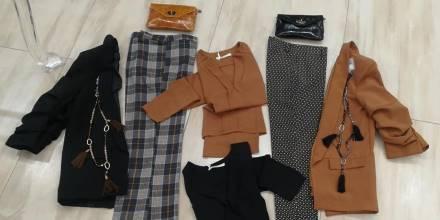 Catia C Concept Store - Maglie, pantaloni e borsetta donna